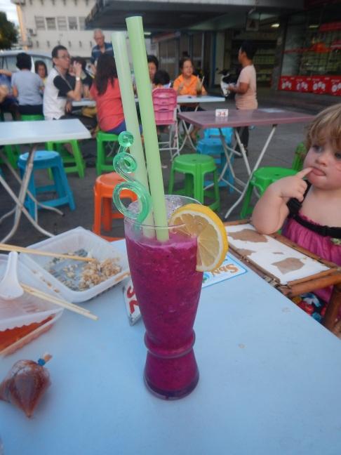 Asha contemplating dragonfruit juice.