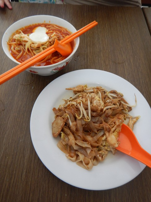 Hokkien mee (Hokkien noodles) and char kuey tiao (high-heat noodles cooked with cockles, prawns and Chinese sausage)